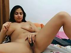 Attractive Indian MILF shows her big tits and masturbates solo